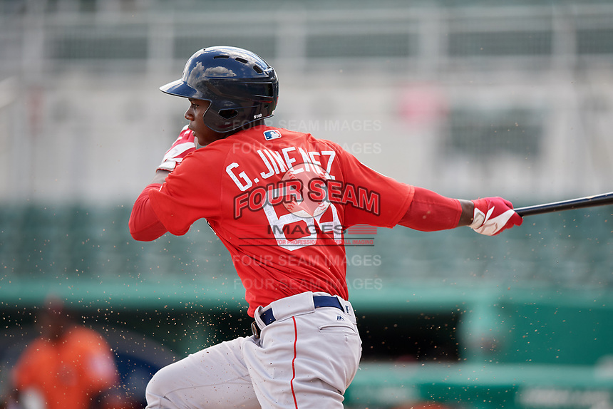 Boston Red Sox designated hitter Gilberto Jimenez (64) follows through on a swing during a Florida Instructional League game against the Baltimore Orioles on September 21, 2018 at JetBlue Park in Fort Myers, Florida.  (Mike Janes/Four Seam Images)