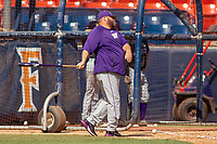 University of Washington Huskies assistant coach Jason Kelly hits ground balls to the infield during pre-game warm-ups at Goodwin Field on June 08, 2018 in Fullerton, California. The University of Washington Huskies defeated the Cal State Fullerton Titans 8-5. (Donn Parris/Four Seam Images)
