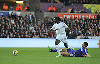 SWANSEA, WALES - JANUARY 17:   of  during the Barclays Premier League match between Swansea City and Chelsea at Liberty Stadium on January 17, 2015 in Swansea, Wales. Bafetimbi Gomis skips past Gary Cahill of Chelsea