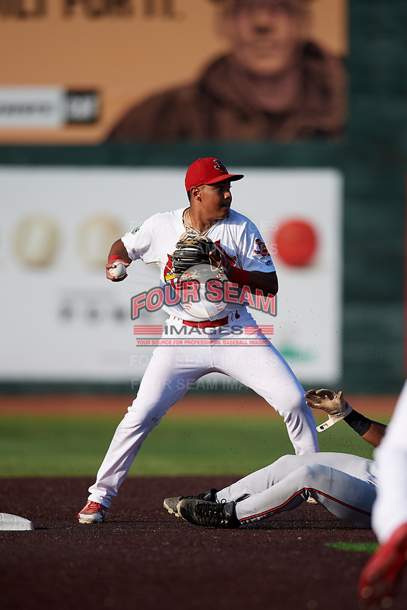 Johnson City Cardinals second baseman Donivan Williams (3) turns a double play during a game against the Danville Braves on July 29, 2018 at TVA Credit Union Ballpark in Johnson City, Tennessee.  Johnson City defeated Danville 8-1.  (Mike Janes/Four Seam Images)