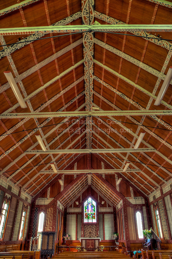 Cultural Syncretism.  Decorated Ceiling and Rafter Supports, St. Mary's Anglican Church, Tikitiki, north island, New Zealand, built 1924-26 as a memorial to Maori soldiers who fought and died in World War I.   A member of the New Zealand Historic Places Trust.  Highway 35, Gisborne Region.