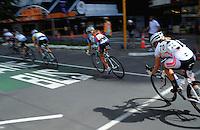NZ's Jeanne Kuhajek (Team Mini NZ, right) chases onto Lambton Quay. NZCT Women's Cycling Tour of New Zealand Stage 6 - Criterium at Lambton Quay, Wellington, New Zealand on Sunday, 27 February 2011. Photo: Dave Lintott / lintottphoto.co.nz