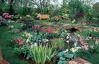 Beautiful garden landscape with bench, water feature, terracing, flowering plants 4172