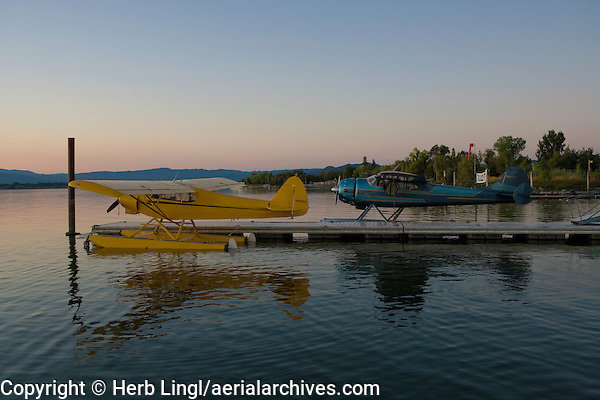 Piper, Cub Crafters Super Cub, PA-18-150, N9901CC and Cessna 195, N3877V, both on floats docked at the Skylark Shores Resort dock, Clear Lake Seaplane Splash-In, Lakeport, Lake County, California