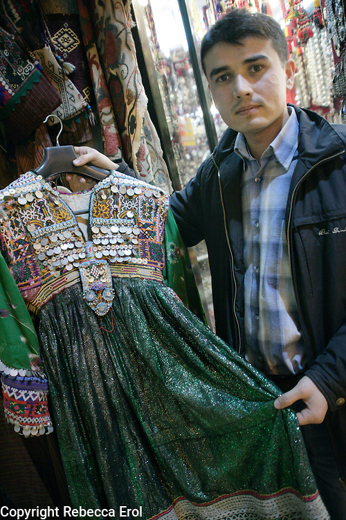 Turkoman showing a traditional dress from his shop at the Grand Bazaar, Istanbul, Turkey