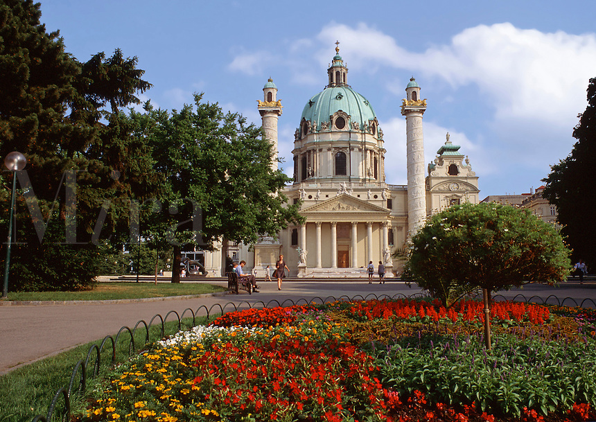 The exterior of St. Charles Cathedral; Baroque style of architecture featuring a dome roof and columns. Vienna, Austria.
