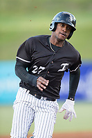 Micker Adolfo (27) of the Kannapolis Intimidators hustles towards third base against the Asheville Tourists at Kannapolis Intimidators Stadium on May 6, 2017 in Kannapolis, North Carolina.  The Intimidators walked-off the Tourists 7-6.  (Brian Westerholt/Four Seam Images)