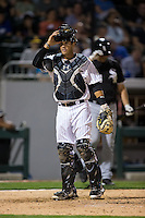 Charlotte Knights catcher Brett Austin (25) looks to the dugout during the exhibition game against the Chicago White Sox at BB&T Ballpark on April 3, 2015 in Charlotte, North Carolina.  (Brian Westerholt/Four Seam Images)