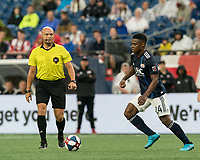 FOXBOROUGH, MA - JULY 17: DeJuan Jones #24 dribbles at midfield during a game between Vancouver Whitecaps and New England Revolution at Gillette Stadium on July 17, 2019 in Foxborough, Massachusetts.