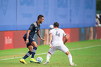 LAKE BUENA VISTA, FL - JULY 22: Khiry Shelton #11 of Sporting Kansas City dribbles the ball during a game between Real Salt Lake and Sporting Kansas City at Wide World of Sports on July 22, 2020 in Lake Buena Vista, Florida.