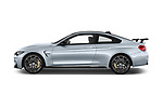 Car driver side profile view of a 2018 BMW M4 Base 2 Door Coupe