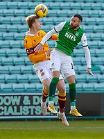 24th April 2021; Easter Road, Edinburgh, Scotland; Scottish Cup fourth round, Hibernian versus Motherwell; Nathan McGinley of Motherwell wins header with Martin Boyle of Hibernian