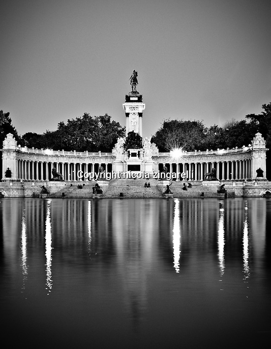 monument to alfonso the XII and the pond at the parque del retiro in madrid