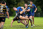 Joe Bywater of Howick upends Cole Waaka of Northcote. Fox Memorial Rugby League, Northcote Tigers v Howick Hornets, Birkenhead War Memorial Park Auckland, Saturday 22nd July 2017. Photo: Simon Watts / www.bwmedia.co.nz