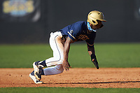 Queens Royals pinch-runner Dominic Ford (6) dives back towards first base during game two of a double-header against the Catawba Indians at Tuckaseegee Dream Fields on March 26, 2021 in Kannapolis, North Carolina. (Brian Westerholt/Four Seam Images)