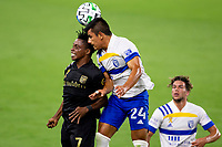 LOS ANGELES, CA - SEPTEMBER 02: Latif Blessing #7 of LAFC and Nick Lima #24 of the San Jose Earthquakes battle for a ball head to head during a game between San Jose Earthquakes and Los Angeles FC at Banc of California stadium on September 02, 2020 in Los Angeles, California.