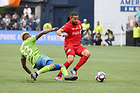 SEATTLE, WA - NOVEMBER 10: Joevin Jones #33 of the Seattle Sounders FC tries to tackle the ball away from Justin Morrow #2 of Toronto FC during a game between Toronto FC and Seattle Sounders FC at CenturyLink Field on November 10, 2019 in Seattle, Washington.