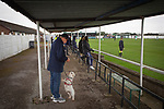 Holker Old Boys 2 Crook Town 1, 10/10/2020. Rakesmoor, FA Vase second round qualifying. A spectator feeding treats to his dog during the first-half as Holker Old Boys take on Crook Town in an FA Vase second round qualifying tie at Rakesmoor, Barrow-in-Furness. The home club was established in 1936 as Holker Central Old Boys and was initially an under-16 team for former pupils of the Holker Central Secondary School. Holker from the North West Counties League beat their Northern League opponents 2-1, watched by a crowd of 147 spectators. Photo by Colin McPherson.
