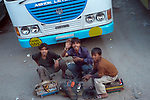 Shoe shine boys at the bus station in Manali, Himachal Pradesh, India.