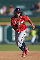 Carlos Paraguate (16) of the Rome Braves hustles towards third base against the Columbia Fireflies at Segra Park on May 13, 2019 in Columbia, South Carolina. The Fireflies walked-off the Braves 2-1 in game one of a doubleheader. (Brian Westerholt/Four Seam Images)