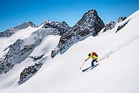 Skiing spring snow on the Steinhüshoren while on a ski tour of the Berner Haute Route, Switzerland