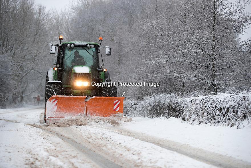 29/12/17<br /> <br /> A tractor with a snow plough clears the A515 near Biggin, Derbyshire.<br /> <br /> All Rights Reserved F Stop Press Ltd. +44 (0)1335 344240 +44 (0)7765 242650  www.fstoppress.com