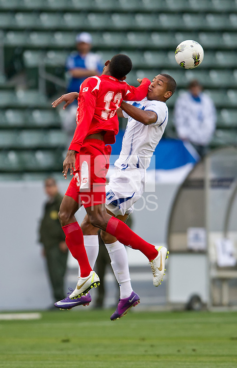 CARSON, CA - March 23, 2012: Eddie Hernandez (13) from Honduras and Roderick Miller (13) from Panama during the Honduras vs Panama match at the Home Depot Center in Carson, California.