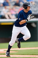 Buck Coats #20 of the Charlotte Knights hustles down the first base line against the Columbus Clippers at Knights Stadium May 25, 2010, in Fort Mill, South Carolina.  Photo by Brian Westerholt / Four Seam Images