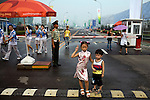 Siblings pose for a photograph for their parents at the security entrance of the Olympic Games venues in Beijing, China on Monday, August 4, 2008. The city of Beijing is gearing up for the opening ceremonies of the Olympic Games.  Kevin German