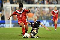 Canada midfielder Desiree Scott (11)  tackled by Becky Sauerbrunn (4).