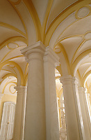 Columned pillars support the stucco vaulted ceiling