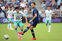 KANSAS CITY, KS - AUGUST 10: Roberto Puncec #4 Sporting KC passes the ball during a game between Club Leon and Sporting Kansas City at Children's Mercy Park on August 10, 2021 in Kansas City, Kansas.