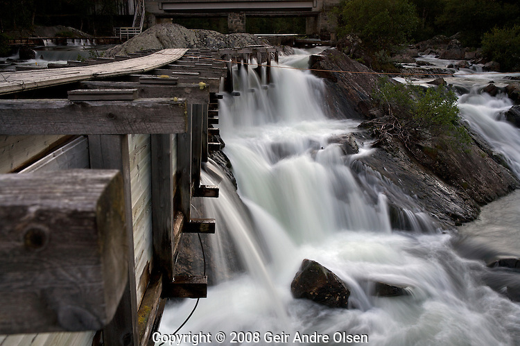 Old water lanes at an old sawmill at Atnafoss by the lake Atna in Folldal, Norway. Water blured by long shutter time.