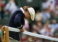 01-07-13, England, London,  AELTC, Wimbledon, Tennis, Wimbledon 2013, Day seven, Lines woman fixing the net<br /> <br /> <br /> <br /> Photo: Henk Koster