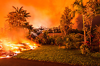 June 2018: Lava from the Kilauea eruption touches the edge of a resident's home and property, Leilani Estates, Puna, Big Island of Hawai'i.