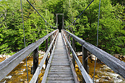 180 foot long suspension bridge along the Wilderness Trail in the Pemigewasset Wilderness, New Hampshire. It spanned the East Branch of the Pemigewasset River just above the East Branch & Lincoln Railroad's trestle No. 17. Built in 1959-1960, the footbridge was dismantled in 2009 because of safety issues.