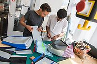 """Das Berliner Start-up """"mimycri"""" produziert Taschen aus den Gummiplanen gestrandeter Fluechtlingsboote.<br /> Statt Griechenlands Straende im Muell der gestrandeten Fluechtlingsboote ersticken zu lassen, stellt das Berliner Unternehmen """"mimycri"""" daraus Taschen und Rucksaecke her und bietet Fluechtlingen eine Chance auf Normalitaet und Regelmaessigkeit.<br /> Im Bild vlnr.: Nora Azzaoui, 30-Jaehrige Unternehmensberaterin aus Berlin und Abid Ali, gefluechteter Schneider aus Pakistan besprechen die Nadelstaerke fuer die Naehte einer Tasche.<br /> 8.8.2017, Berlin<br /> Copyright: Christian-Ditsch.de<br /> [Inhaltsveraendernde Manipulation des Fotos nur nach ausdruecklicher Genehmigung des Fotografen. Vereinbarungen ueber Abtretung von Persoenlichkeitsrechten/Model Release der abgebildeten Person/Personen liegen nicht vor. NO MODEL RELEASE! Nur fuer Redaktionelle Zwecke. Don't publish without copyright Christian-Ditsch.de, Veroeffentlichung nur mit Fotografennennung, sowie gegen Honorar, MwSt. und Beleg. Konto: I N G - D i B a, IBAN DE58500105175400192269, BIC INGDDEFFXXX, Kontakt: post@christian-ditsch.de<br /> Bei der Bearbeitung der Dateiinformationen darf die Urheberkennzeichnung in den EXIF- und  IPTC-Daten nicht entfernt werden, diese sind in digitalen Medien nach §95c UrhG rechtlich geschuetzt. Der Urhebervermerk wird gemaess §13 UrhG verlangt.]"""