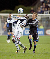 New England  forward Kheli Dube (left) fights for a loose ball with San Jose defender Chris Leitch (4).  New England defeated the San Jose Earthquakes 1-0 at Buck Shaw Stadium in Santa Clara, California on Saturday, March 21, 2009.