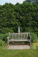 Bench under hedges