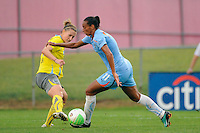 Jen Buczkowski (4) of the Philadelphia Independence defends Rosana (11) of Sky Blue FC. Sky Blue FC defeated the Philadelphia Independence 1-0 during a Women's Professional Soccer (WPS) match at Yurcak Field in Piscataway, NJ, on August 22, 2010.