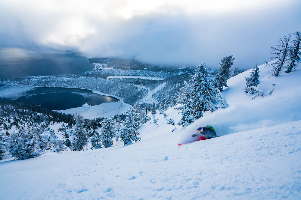 Michelle Parker skiing above a rarely frozen Emerald Bay, CA