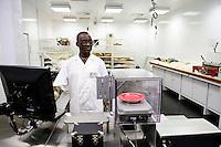 BURKINA FASO , Bobo Dioulasso, Société Burkinabè des Fibres Textiles SOFITEX cotton ginning company unit Bobo III, processing of conventional and gene manipulated Monsanto BT cotton / SOFITEX, Fabrik fuer Baumwollentkernung Werk Bobo III, Verarbeitung von konventioneller und genmanipulierter Monsanto Baumwolle, Im Labor<br /> ANSELME KABORÉ
