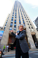 """Gloria Clyne poses in front of 30 Rockefeller Plaza wearing a contemporary NBC page jacket, New York, NY on March 18, 2010.  Clyne, 83, worked 55 years for NBC, starting out as one of the network's first female pages in 1944 and working her way up from page to """"floor wash girl"""" to """"script girl"""" and finally to production assistant as TV replaced radio inside NBC.."""