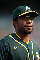 OAKLAND, CA - SEPTEMBER 25:  Elvis Andrus #17 of the Oakland Athletics walks off the field in between innings against the Houston Astros during the game at the Oakland Coliseum on Saturday, September 25, 2021 in Oakland, California. (Photo by Brad Mangin)