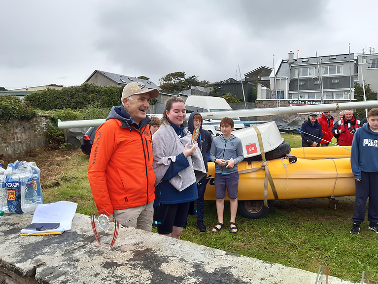 Aoife Ní Chonchubhair of CSS, who came second with Hooriya Awan in the Pico/Topaz class at Spiddal regatta 2021, with commodore Dave Cahill. Photo: Jamie Donald