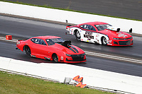 Jul 19, 2020; Clermont, Indiana, USA; NHRA pro mod driver Jason Scruggs (near) races alongside Bo Butner during the Summernationals at Lucas Oil Raceway. Mandatory Credit: Mark J. Rebilas-USA TODAY Sports