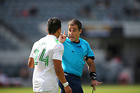 LOS ANGELES, CA - APRIL 17: Nick Lima #24 of Austin FC is receiving a scolding from referee Alex Chilowicz during a game between Austin FC and Los Angeles FC at Banc of California Stadium on April 17, 2021 in Los Angeles, California.
