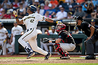 Michigan Wolverines designated hitter Jordan Nwogu (42) follows through on his swing during Game 1 of the NCAA College World Series against the Texas Tech Red Raiders on June 15, 2019 at TD Ameritrade Park in Omaha, Nebraska. Michigan defeated Texas Tech 5-3. (Andrew Woolley/Four Seam Images)