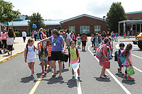 ALTERED STATE PHOTO ESSAY/ANDREW SHURTLEFF<br /> Students at Baker-Butler Elementary School walk to their buses.<br /> <br /> Shut downs and stay-in-place orders, the most recent of which came from Gov. Ralph Northam Monday, have left Charlottesville dormant. Students have been sent home, many businesses have shut their doors and events have been canceled. In this photo essay, photographer Andrew Shurtleff has spent time capturing the effects of the pandemic and comparing the duality of the present with our social past.