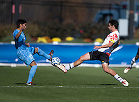 John Stertzer (27) of Maryland stretches for a 50-50 ball with Danny Garcia (17) of North Carolina during the game at the Maryland SoccerPlex in Germantown, MD. Maryland defeated North Carolina, 2-1,  to win the ACC men's soccer tournament.